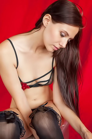 The aptly named Vanessa Angel looks resplendent in sexy see-through black lingerie