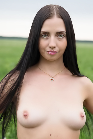 Chick in green grass