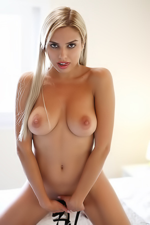 Glamour Blond Model Gets Out Of Black Lingerie